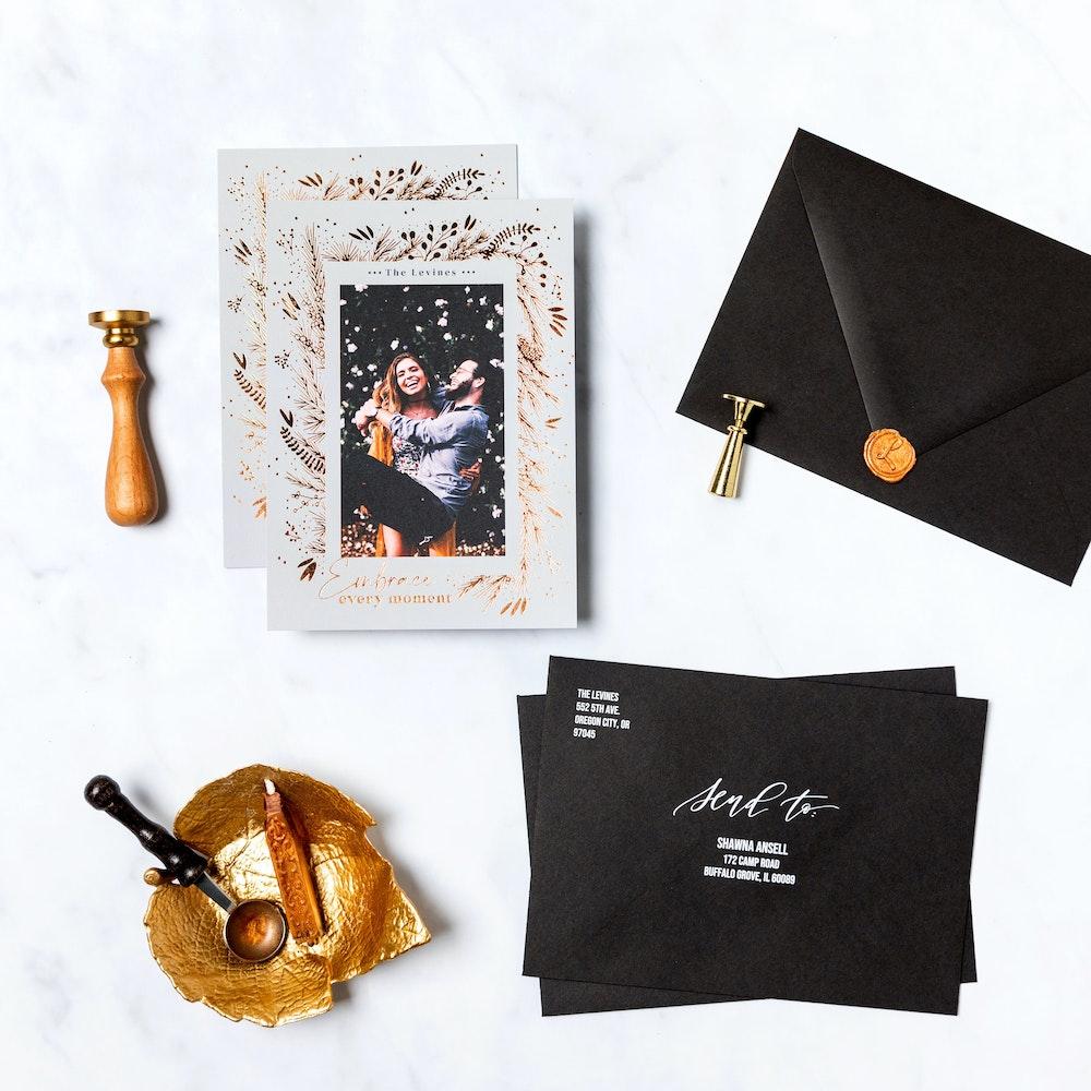 Gold foil pressed 5x7 Flat Cards with recipient addressing on black premium envelopes