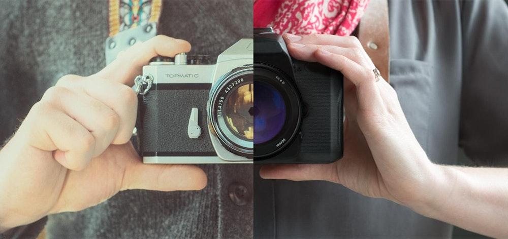 Hands holding film and digital cameras