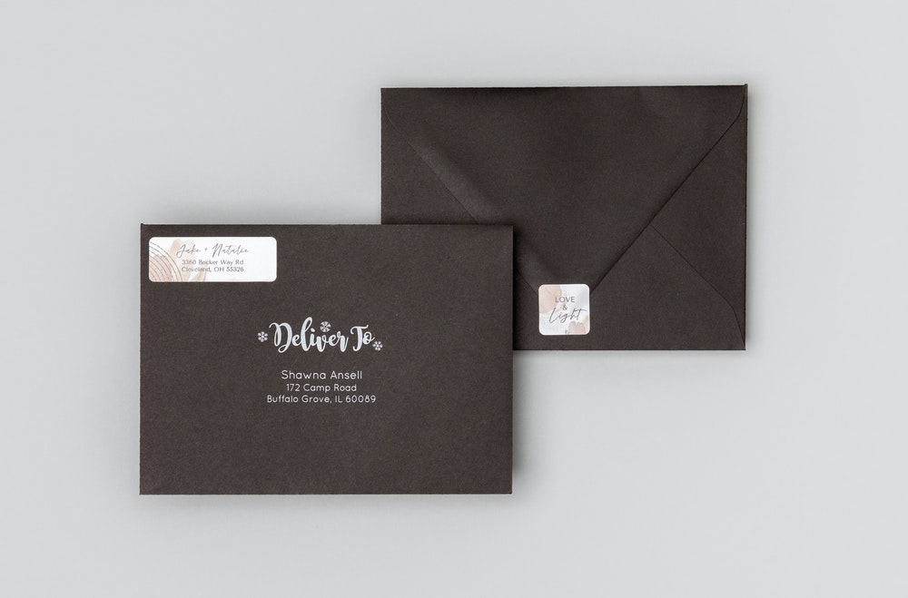Black premium envelopes with matching address label and seal sticker designs
