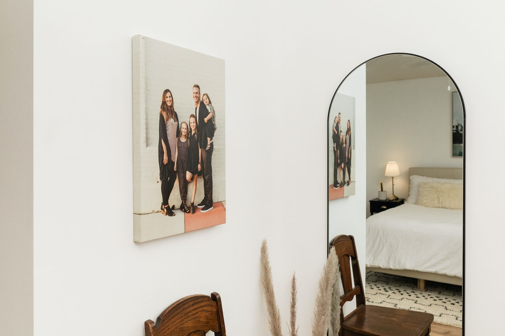 Family portrait Gallery Wrap hanging on bedroom wall