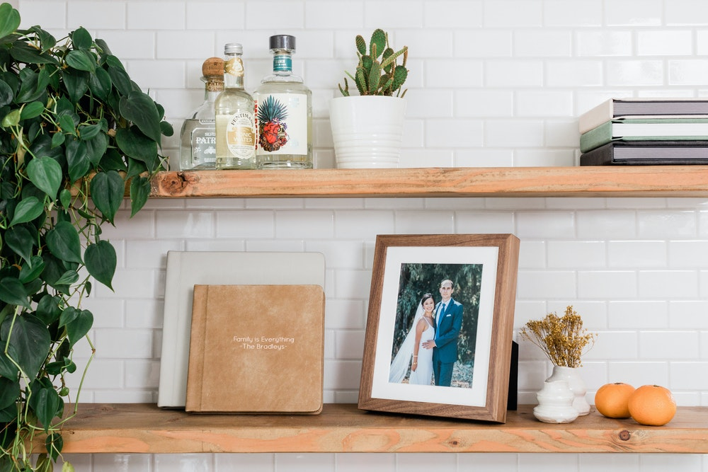 Framed Tabletop Prints and Premium Albums on kitchen shelf