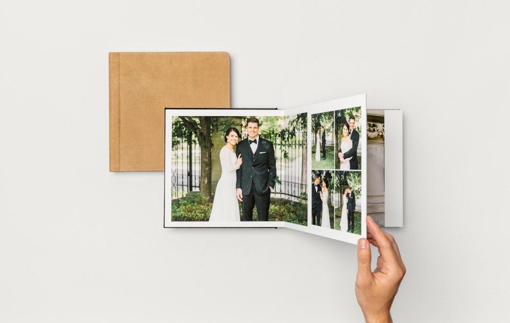 Hand turning leather wedding Album spread