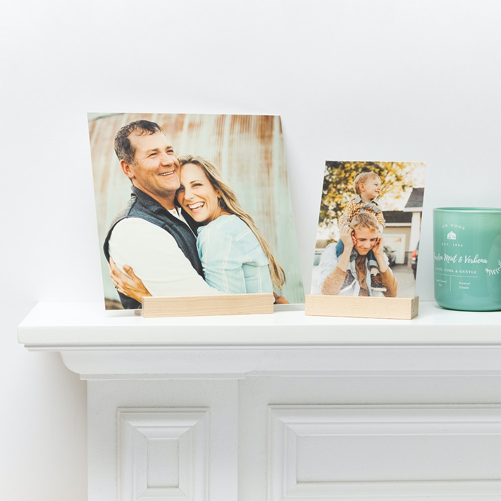 Mounted Photographic Prints in Maple Wood Display Stands on mantle