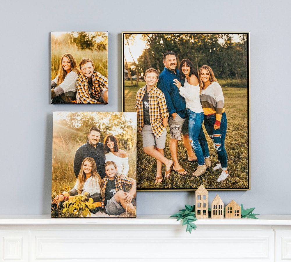 Wall collage of multiple Gallery Wraps and Float Frame above fireplace mantel