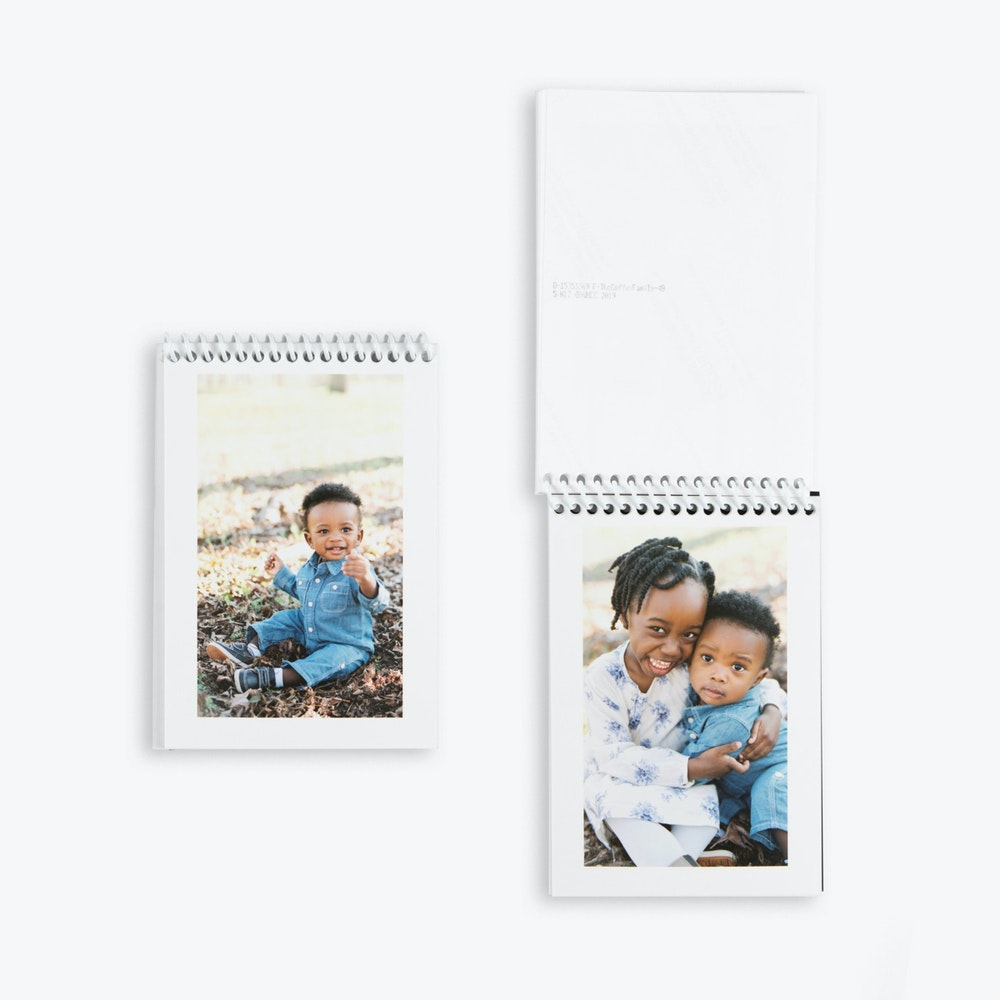 Open and closed white spiral bound Proof Prints