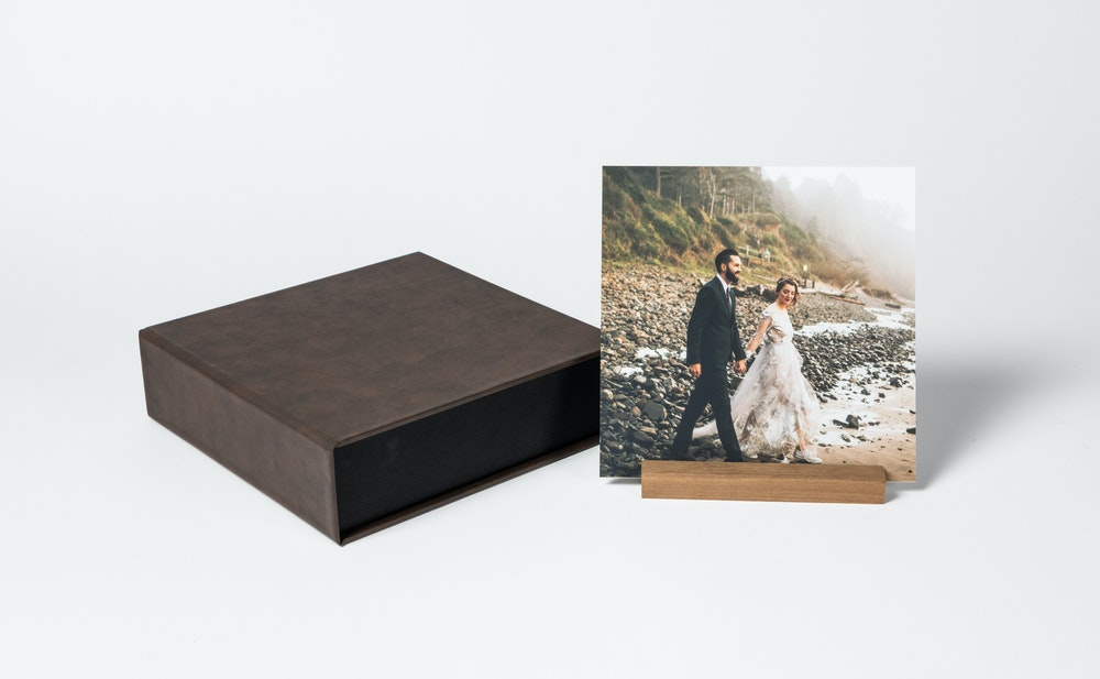Square material cover Image Box with mounted prints and wood display stand