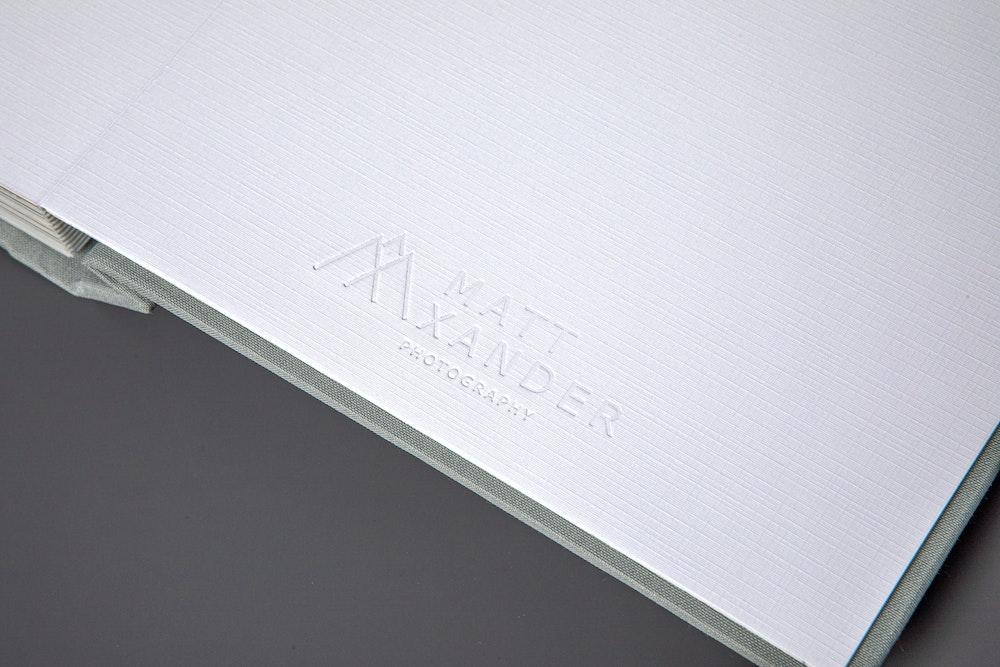 Blind custom debossing on white endleaves detail